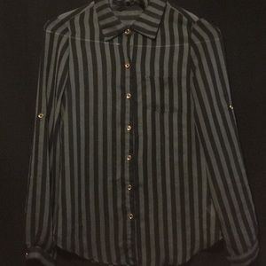green and black striped blouse